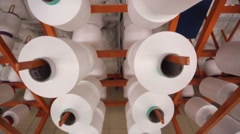 factory of knitted underwear, coils synthetic thread. Spools of thread. - stock footage