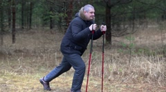 Hiker with overweight do exercises for legs in forest Stock Footage