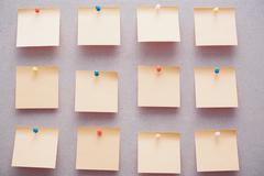Sticky notes on a bulletin board - stock photo