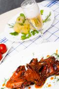 Chicken  grilled with boiled potatoes and marinated tomatoe Stock Photos