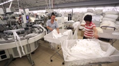 Woman at work in a factory of knitted underwear. Stock Footage