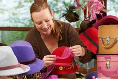 Hat Maker Working On Design In Studio - stock photo