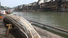 An old rowing boat is renovated in Fenghuang, China - stock footage