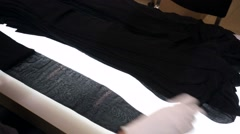On the production line, worker package new women's pantyhose. Stock Footage