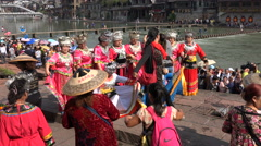 China domestic tourism, women dress up in minority clothing in old village Stock Footage
