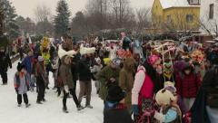 Ethnics carnival Masopust, people walk on street. Editorial ethnic doc Stock Footage