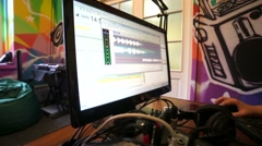 "Radio ""Play FM"" live in studio. Dj edit radio timeline on a computer. Stock Footage"