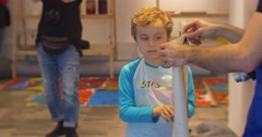 Family Master Class Opole Art Gallery Kid Shows His Drawing Black Letters on Stock Footage