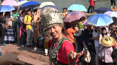 Chinese woman poses for a photographer in colorful traditional dress Stock Footage