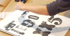 Kid Putting a Stamps Black Letters in Art Gallery Drawing at Master Class Stock Footage