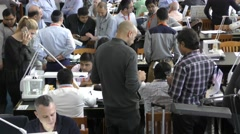Tlit: Wide view: Israeli companies exhibiting their goods on the trading floor - stock footage