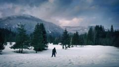 Man Walks Through Deep Snow In Frozen Landscape Stock Footage
