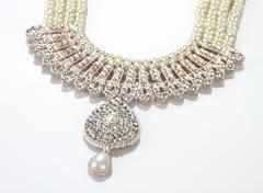 Modern Intricate Indian Jewellery Diamond Necklace on White Background - stock photo