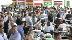 Pan: Wide view: Israeli companies exhibiting their goods on the trading floor - stock footage