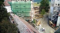 Construction site of a historic building. Workers working on restoring old walls - stock footage
