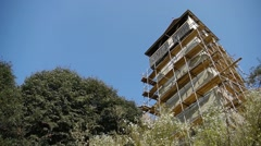Image with the tower covered in scaffolding of an old fortress, surrounded - stock footage