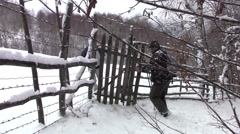 Tourists who go backpacking passing through a wooden gate, following the path - stock footage