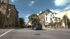 Traffic on Corner in Town Stock Footage