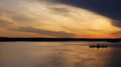 Lone boat at orange sunset in Baltic sea Stock Footage