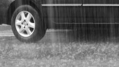 Rainfall in the city. Black car on wet asphalt Stock Footage