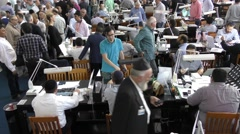 Israeli companies exhibiting their goods on the trading floor - stock footage