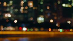 Bokeh Effect Drifting into Focus on Night Time Cityscape Stock Footage