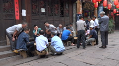 China recreation, men play Chinese chess board games in traditional setting Stock Footage