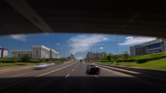 Car drives on street Traffic over the wide boulevards of Astana timelapse Stock Footage