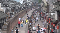 Tourists walk through traditional renovated shopping streets in Fenghuang, China Stock Footage