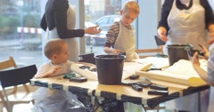 Master Class Opole Art Gallery Kids Print a Black Letters at the Table Painting Stock Footage