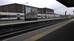 Railroad passenger trains passing at station 4K Stock Footage