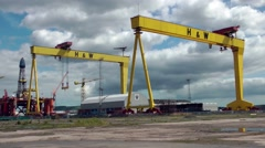 Gantry cranes Samson and Goliath Belfast shipbuilding Stock Footage