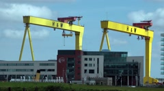 Samson and Goliath large gantry cranes blue sky Belfast Stock Footage