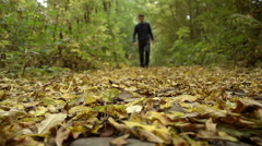 A hiker with walking boots is walking through an autumnal wood Stock Footage