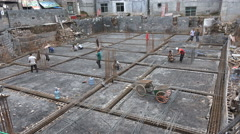 Construction site, medium sized city in China, workers scaffolding, steel frame Stock Footage