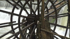 Turning water wheel in a traditional village in China - stock footage