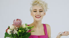 Funny woman with a bouquet of exotic flowers Stock Footage