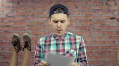 Blogger read script on paper, start speak. Feets in leopard shoes on background - stock footage