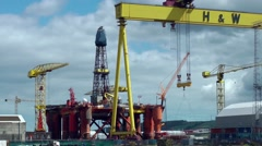 Oil rig construction gantry crane Belfast - stock footage