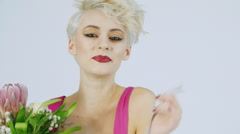 Beautiful woman with short blond hair - stock footage