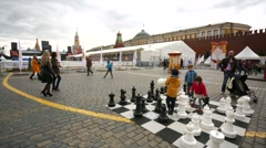 Children play chess with large figures at the Red Square. Stock Footage