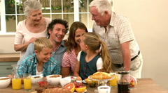 Multi generation family having breakfast - stock footage