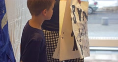 Family Master Class Opole Art Gallery Kid Shows His Black Paint Drawing on Stock Footage