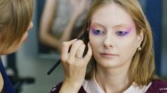 Beauty saloon. Women apply make-up Stock Footage