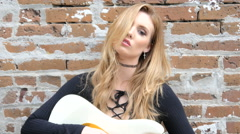 Sexy hipster girl with electric guitar outdoors Stock Footage