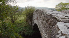 Old Welsh Stone Bridge In The Welsh Countryside - stock footage