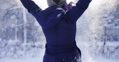 Happy girl throws snow up several times Stock Footage