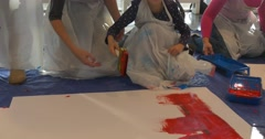 Kids With Mums Are Painting on Paper on Floor Art Gallery People Paint in Stock Footage