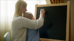 Mother Teaching Son Numbers - stock footage