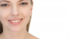 Beautiful young blonde woman toothy smile - stock footage